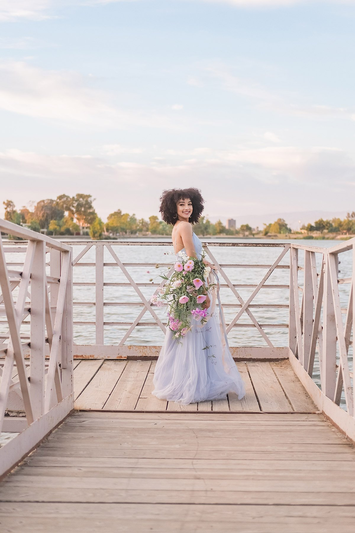 bride holding flower bouquet on a lake in Los Gatos