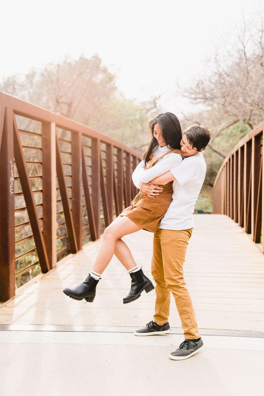 happy lesbian couple on bridge