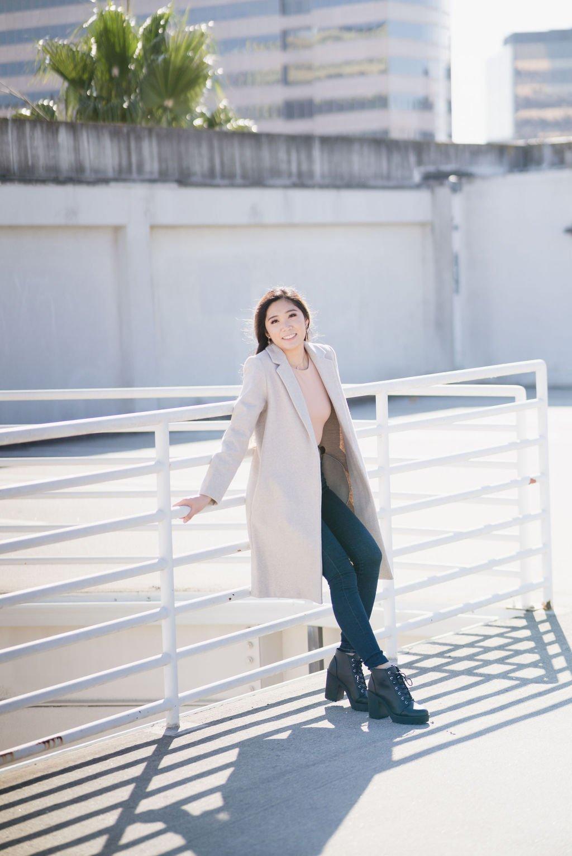 business woman on railings