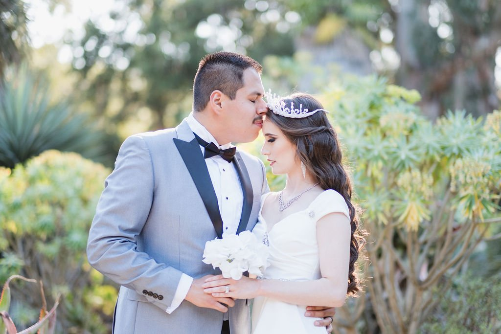 bride and groom closed eyes kiss