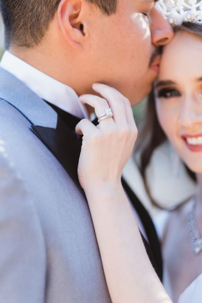 diamond ring and smiling bride