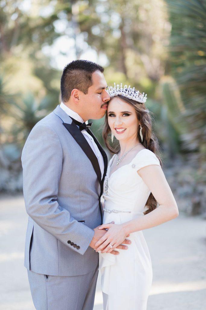 bride and groom lovingly embracing at Arizona Cactus Garden