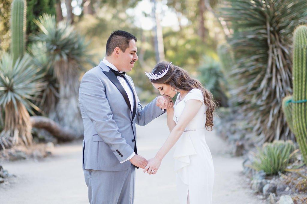 bride kissing groom's hand