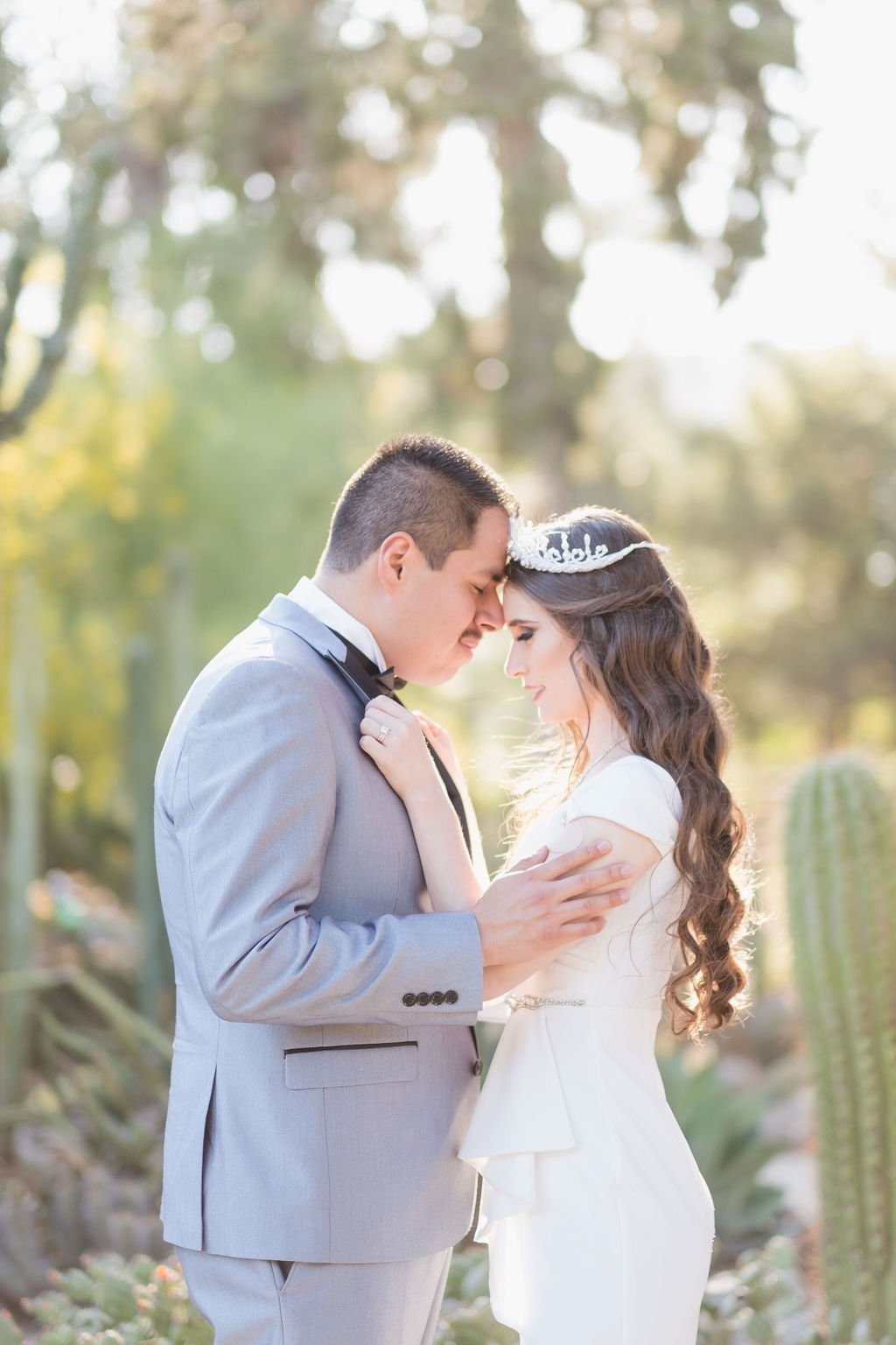 bride and groom lovingly embracing at Arizona Cactus Garden