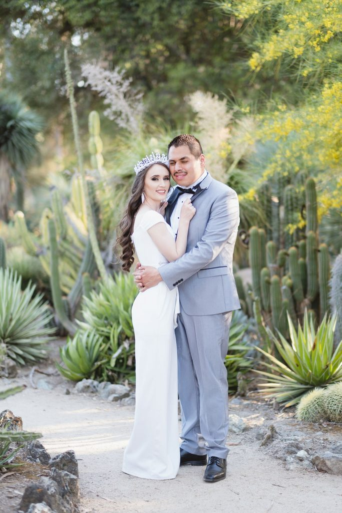 couple surrounded by cacti