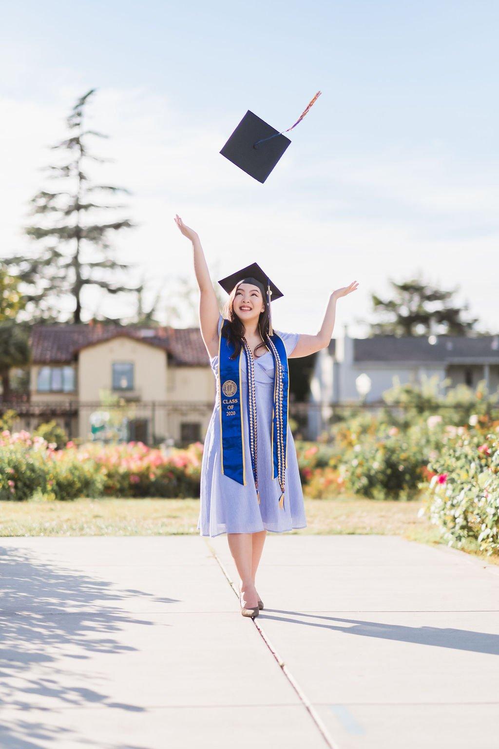 Graduate throwing cap in the air