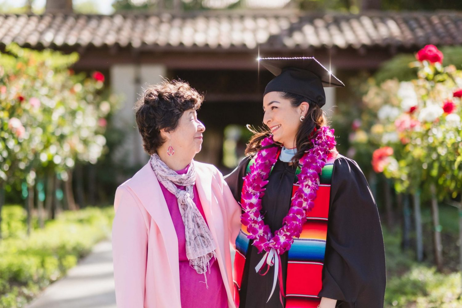 smiling santa clara university graduate with her mother