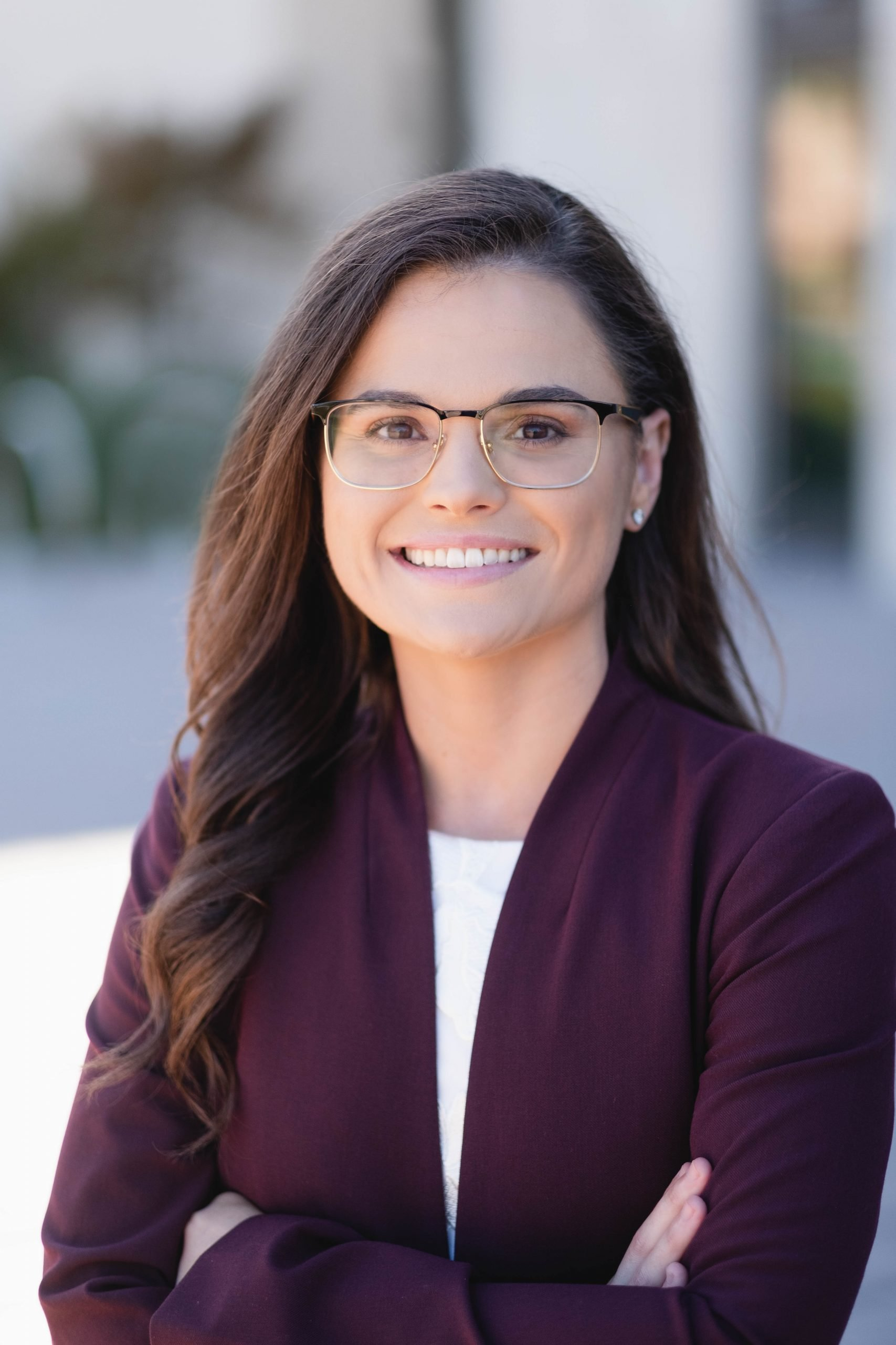 woman with glasses head shot