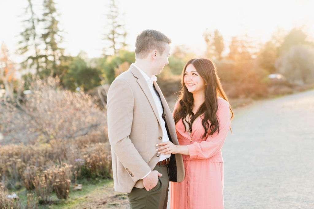 gilfriend holding boyfriend's blazer outside