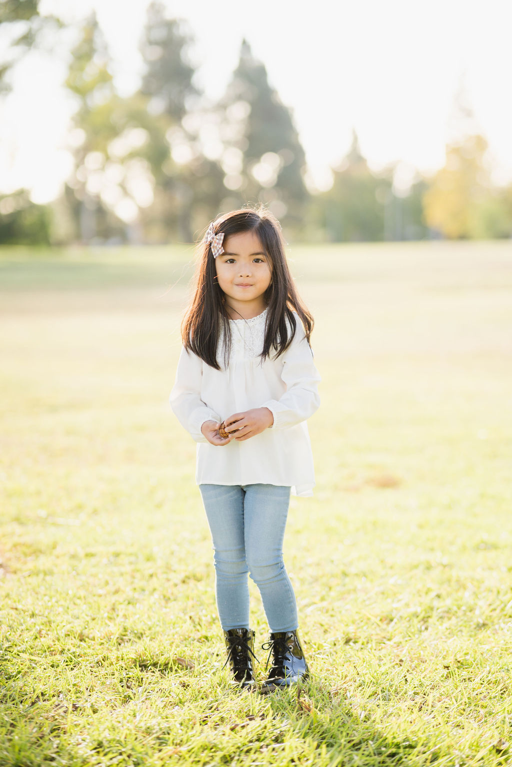 young girl on grassy field