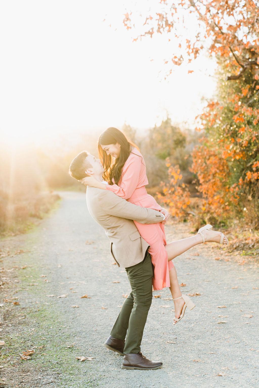 boyfriend lifting up girlfriend