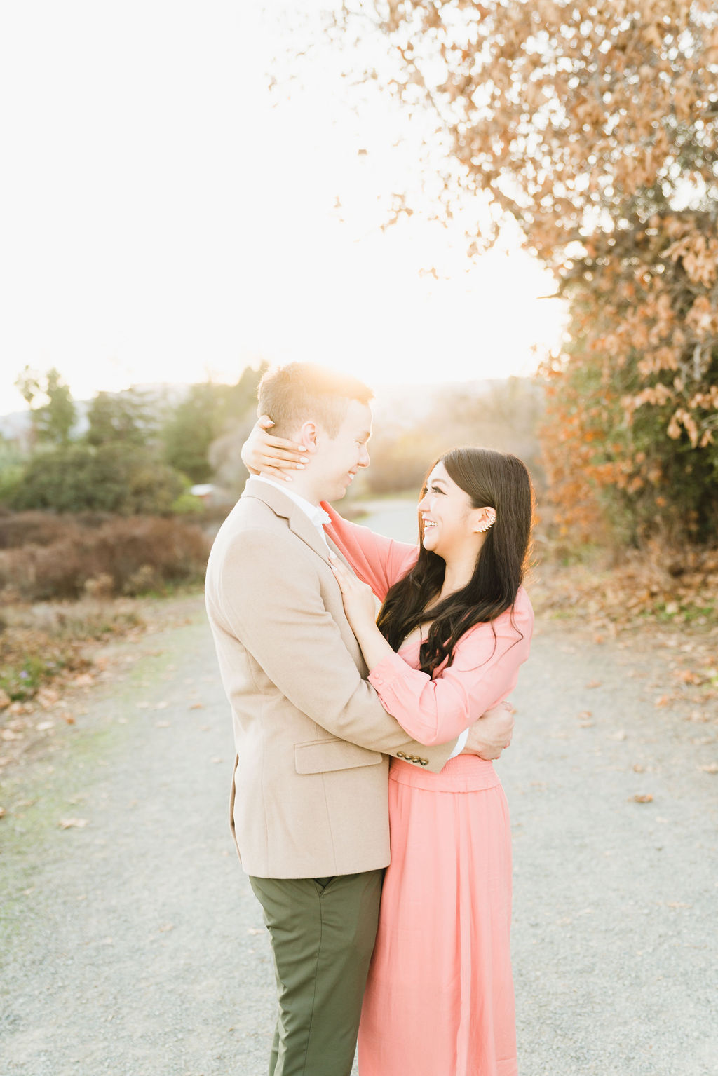 woman in pink dress embracing with her boyfriend