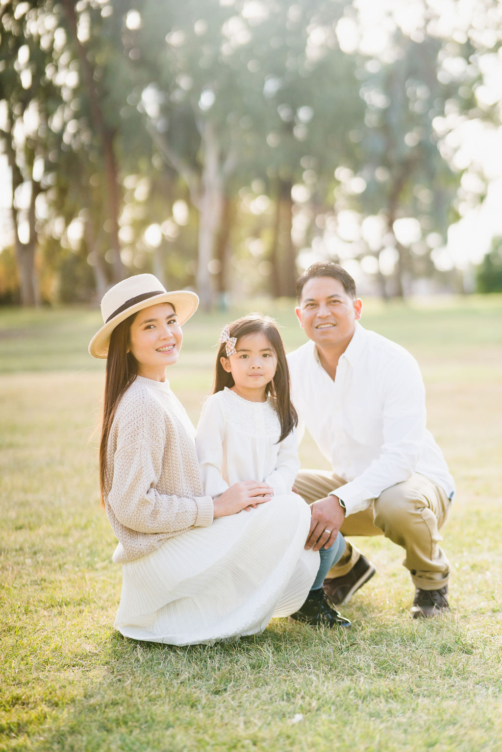 family sitting on grassy area of central park fremont