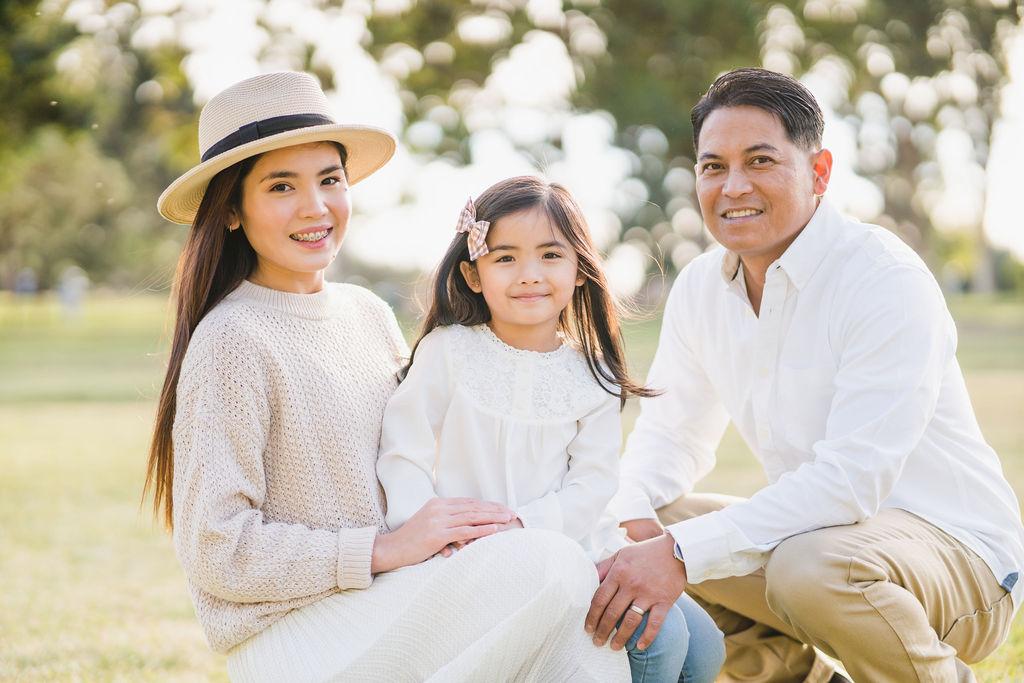 family smiling at the camera