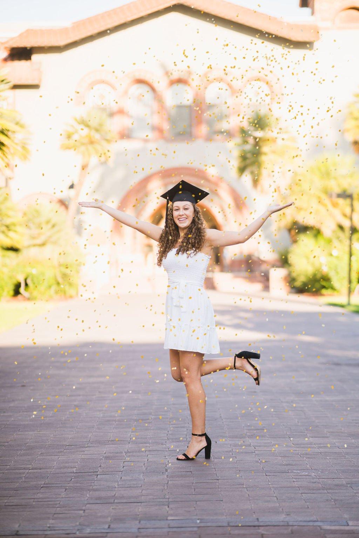 Graduate Throwing Glitter
