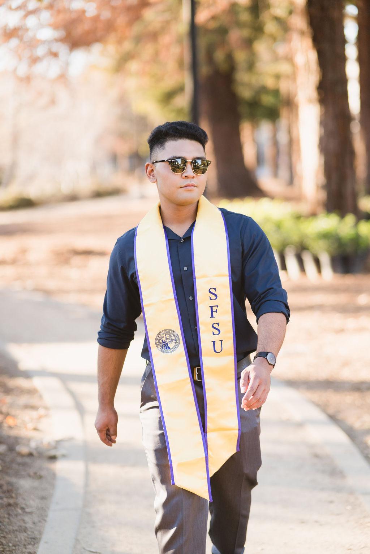SFSU male Graduate wearing sunglasses