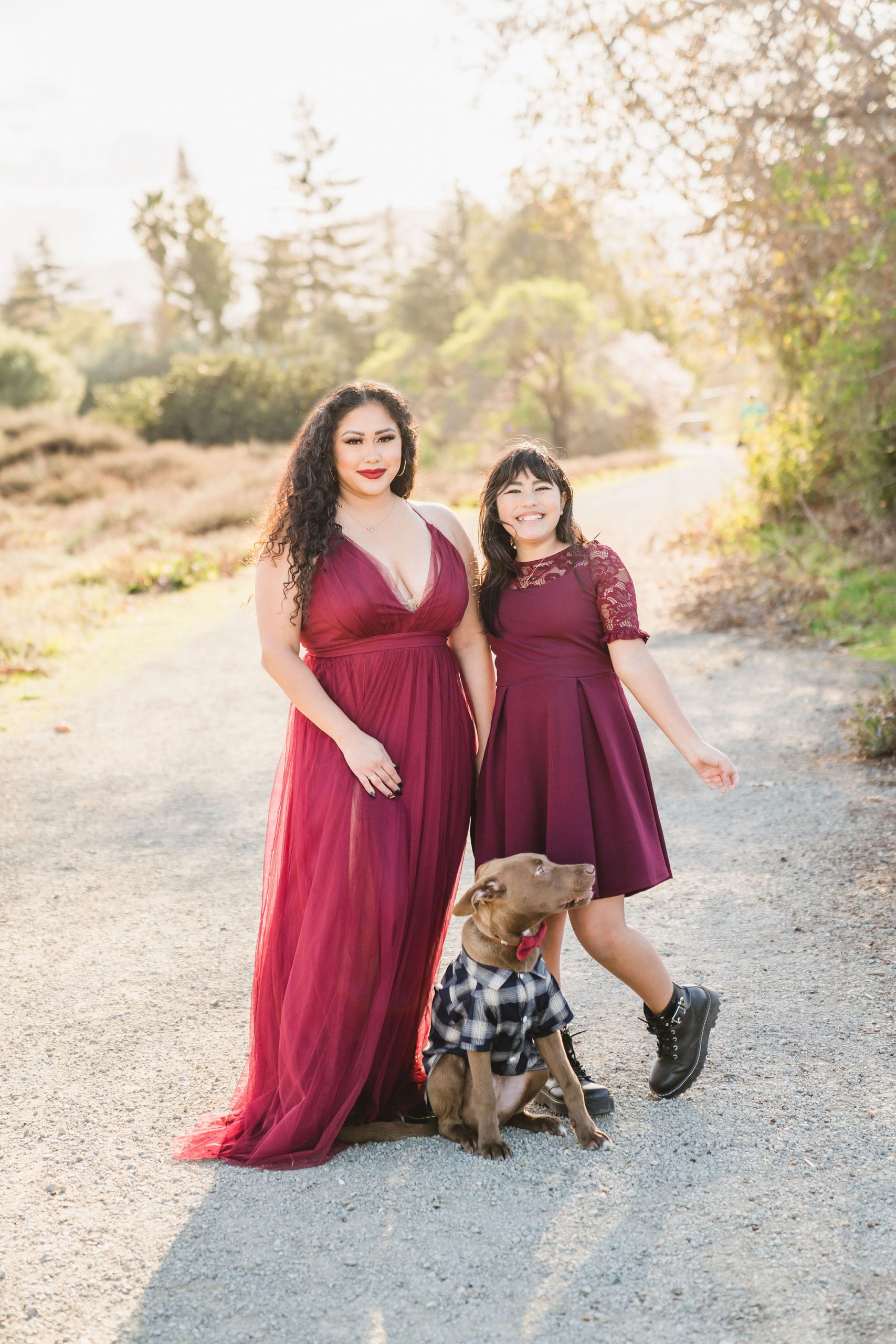mother, daughter, and puppy standing on Los Gatos Creek